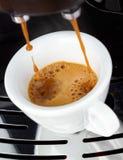 Fresh Espresso coffee. Fresh steaming espresso coffee being made