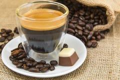 Fresh espresso coffee with crema with pralines Stock Image