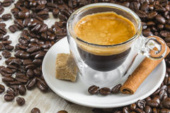 Fresh espresso coffee in transparent glass with golden crema Royalty Free Stock Image