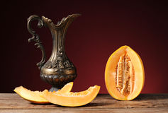 Fresh excised melon and carafe of metal Stock Photo