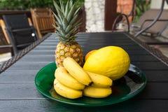Fresh exotic fruits on  black table Royalty Free Stock Image