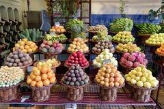 Fresh exotic fruits on a market in Funchal, Madeira. Fresh exotic fruits on famous market in Funchal Mercado dos Lavradores, Portuguese island of Madeira stock photos