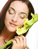 Fresh face with gladiolus flowers in her hands Royalty Free Stock Images