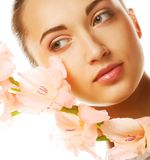 Fresh face with gladiolus flowers in her hands Royalty Free Stock Photo