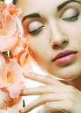 Fresh face with gladiolus flowers in her hands Stock Photo