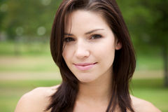 Fresh Faced Girl With Green Background Royalty Free Stock Images