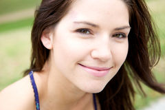 Fresh Faced Woman. A Beautiful Fresh Faced Woman smiling at the camera Royalty Free Stock Photos