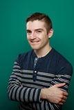 Fresh Faced Young Man. Series of studio lifestyle shots of a casual fresh caucasian man in a stylish casual outfit on a teal blue background with room for copy Stock Photography