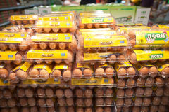 Fresh Farm Chicken Eggs, supermarket. Stacks of chicken eggs in a plastic container sell by a dozen in a supermarket shelves Royalty Free Stock Image