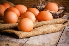 Fresh farm eggs on sacking Royalty Free Stock Photos