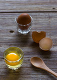 Fresh farm eggs on a wooden. Background Royalty Free Stock Image