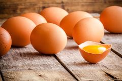 Fresh farm eggs. On a wooden rustic background stock photography