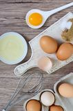 Fresh farm eggs on a wooden rustic background. Royalty Free Stock Photography