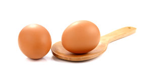 fresh farm eggs in wooden spoon on white background stock photo