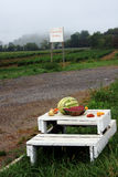 Fresh farm fruit. A table with fresh vegetables and fruits on the side of a road and a sign  saying 'Farm Fresh Produce Stock Image