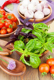 Fresh farmers tomatoes and basil. On wood table Royalty Free Stock Photos