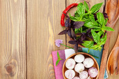 Fresh farmers tomatoes and basil. On wood table with copy space Stock Photography