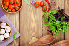 Fresh farmers tomatoes and basil. On wood table with copy space Stock Photos