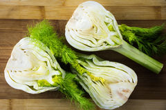 Fresh fennel on wooden cutting boarg, kitchen. Royalty Free Stock Photo