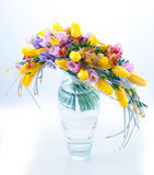 Fresh festive bouquet of flowers in glass vase. Fresh festive bouquet of colorful flowers in vase on white background stock photography