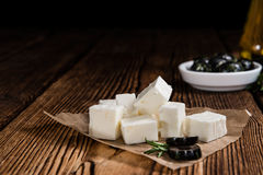 Fresh Feta Cheese. (detailed close-up shot) on vintage background royalty free stock photos
