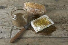 Fresh feta cheese full of olive oil, oregano vase and a bread Stock Photos