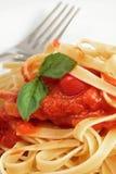 Fresh Fettuccine With Spaghetti Sauce. A Close Up View Of Fresh Fettuccine With Spaghetti Sauce And Basil Leaf Stock Images