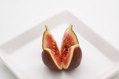 Fresh fig. Fruit on white plate Royalty Free Stock Photos