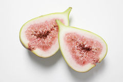 Fresh fig. Halved on a white background Royalty Free Stock Photography