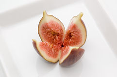 Fresh fig fruit on white plate Royalty Free Stock Images