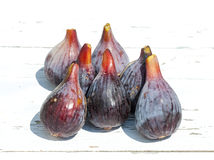 Fresh fig fruits on white wooden background Royalty Free Stock Photo