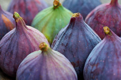 Fresh fig fruits. On a wooden table royalty free stock photography