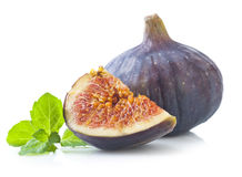 Fresh fig with green mint  leaves Stock Photography
