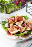 Fresh Fig salad on dark wooden background. stock photos