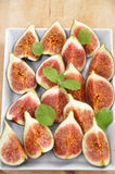 Fresh Figs. With mint on a plate stock images