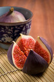 Fresh figs. On the bamboo mat background royalty free stock photos