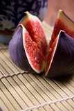 Fresh figs. On the bamboo mat background stock image