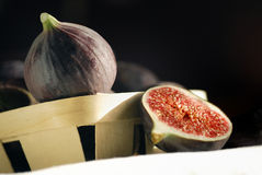 Fresh figs. Meditarranean figs and basket, one cutted stock images