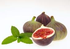 Fresh figs. Autumn fruits on white background Royalty Free Stock Images