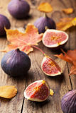 Fresh figs and autumn leaves Stock Photos