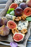 Fresh figs with blue cheese on a bronze tray. Royalty Free Stock Image