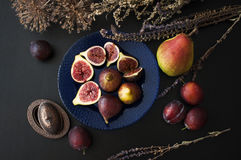 Fresh figs on a blue plate Royalty Free Stock Photos