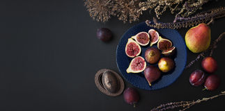Fresh figs on a blue plate Stock Photos