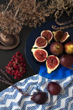 Fresh figs on a blue plate Royalty Free Stock Images