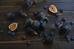 Fresh figs and blueberries on the wooden table Royalty Free Stock Photo