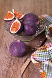 Fresh figs, old knife and chequered towel Royalty Free Stock Photography