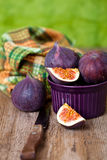 Fresh figs in a bowl, old knife and towel Stock Photos