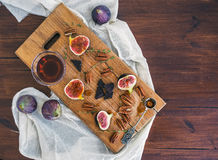 Fresh figs, chocjlate and pekan nuts with honey on a wooden boar Royalty Free Stock Photos