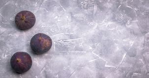 Fresh figs on concrete background, side view. Close-up. royalty free stock photos