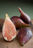 Fresh Figs on a cutting board. Figs sliced and ready to be cooked. A beautiful arrangement of fresh figs Stock Image